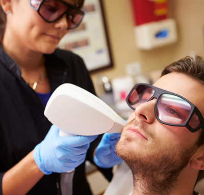 man-having-facial-laser-treatment