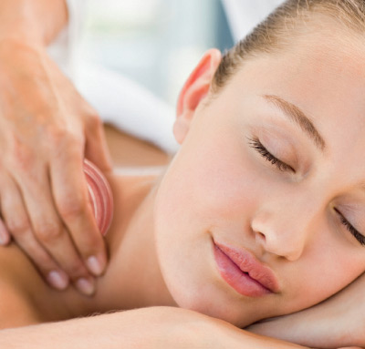woman-receiving-lava-massage-treatment